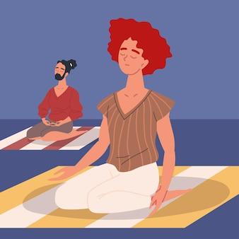 Para siedzi w medytacji
