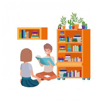 Para siedzi ze stosu książek