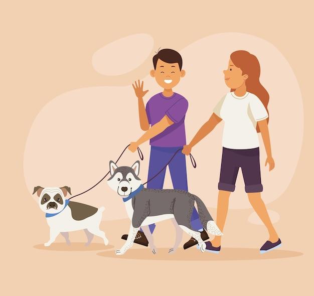 Para spacerująca z psami
