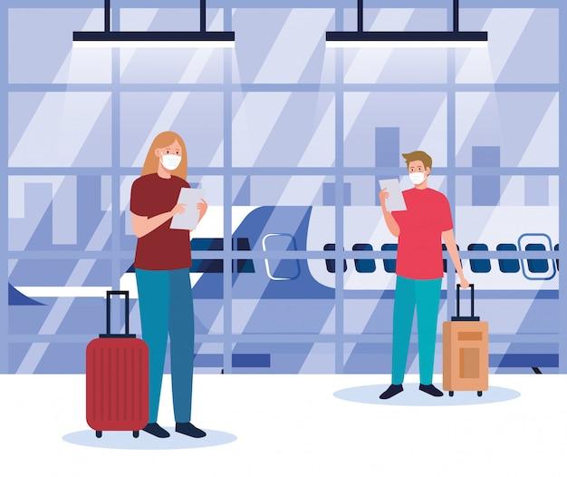 Para w masce medycznej w terminalu lotniska, podróżująca samolotem podczas pandemii koronawirusa, zapobieganie covid 19