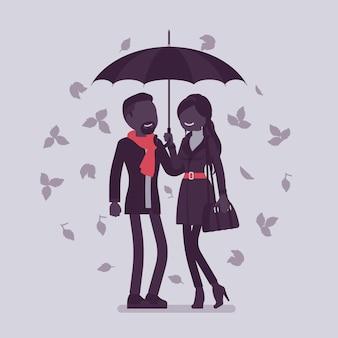 Para z parasolem jesienią. zakochany mężczyzna i kobieta stoją razem chronieni pod deszczem jesiennych liści, czując się bezpiecznie, bezpiecznie, romantyczny związek. ilustracja wektorowa, postacie bez twarzy