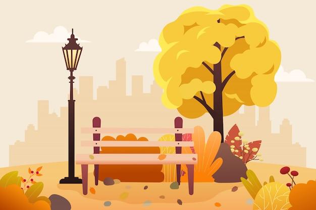 Park publiczny z ławką i opadającymi liśćmi.