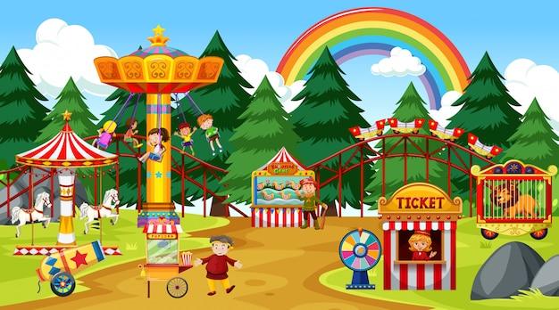 Park rozrywki scena przy dniem z tęczą w niebie