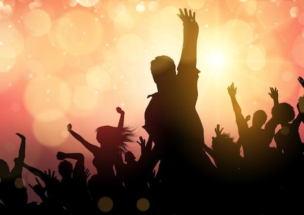 Partyjny tłum na bokeh świateł tle