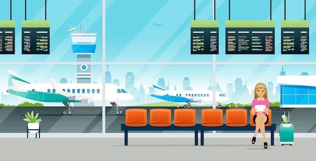 Pasażerka czeka na wejście do samolotu z bagażem.