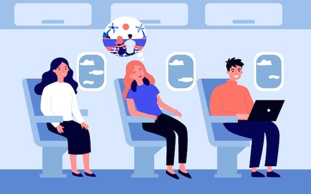 Pasażerowie samolotu podczas lotu