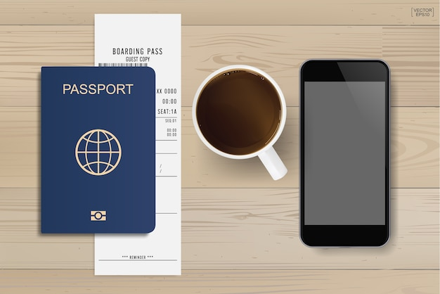 Paszport i bilet na pokład z filiżanką kawy i smartfonem na tle drewna