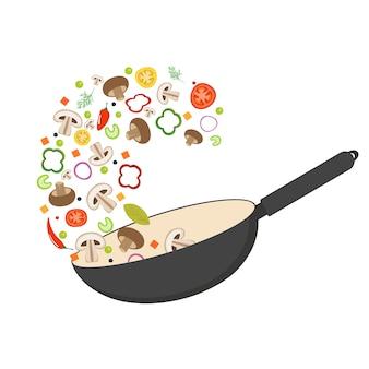 Patelnia do woka, pomidor, papryka, pieprz, grzyb shiitake i marchewka. azjatyckie jedzenie. świeże latające warzywa.