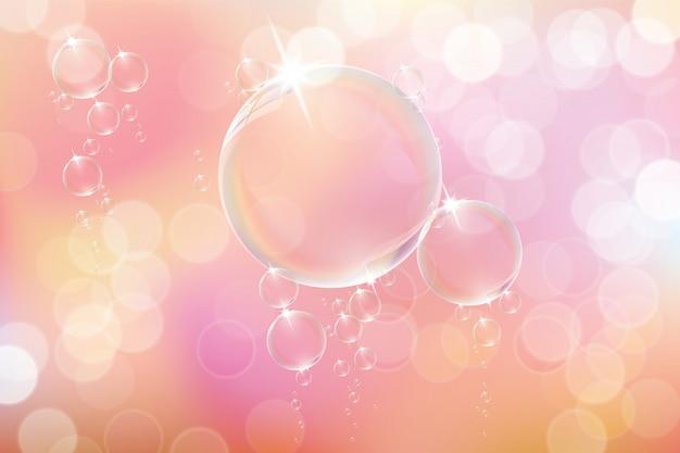 Pęcherzyki mydlane na różowym tle.