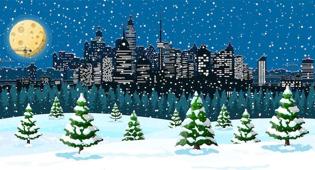 Pejzaż zimowy, płatki śniegu i drzewa. aleja śnieżna w parku miejskim i budynki.