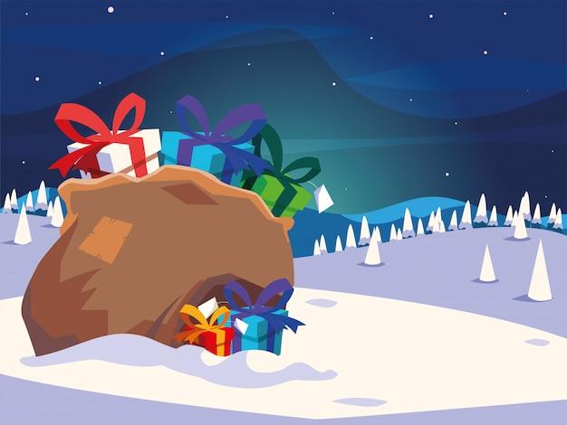 Pełna torba prezentów od świętego mikołaja w zimowym krajobrazie