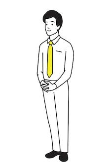 Pełnej długości młody biznesmen stojący samotnie