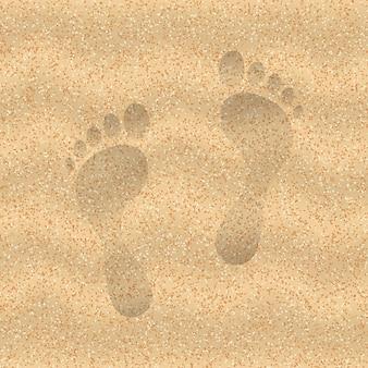 Piasek na plaży ze śladem stóp