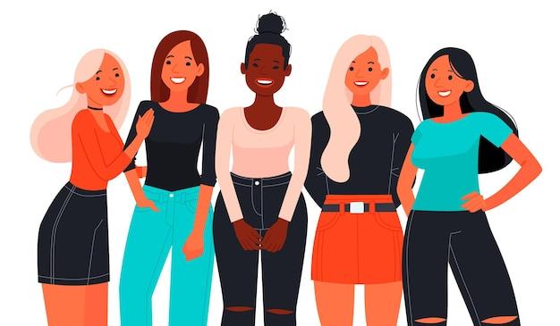 Pięć młodych kobiet lub pięknych dziewczyn ubranych w modne ubrania, stojących razem. grupa przyjaciółek i aktywistek feminizmu. famale ruch.