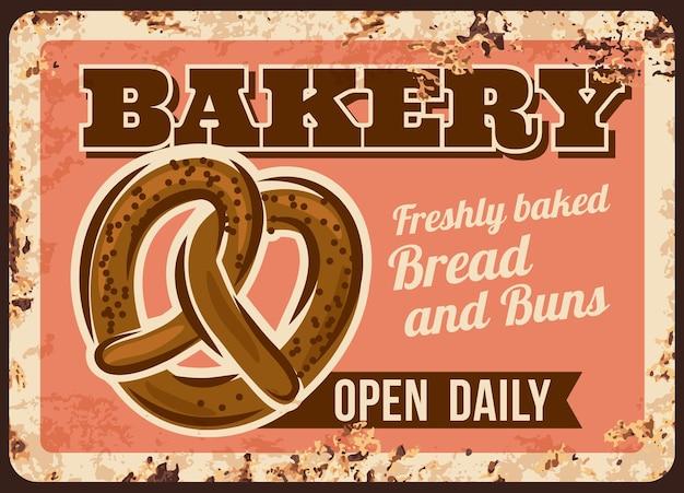 Piekarnia chleb precel metalowy talerz lub zardzewiały plakat
