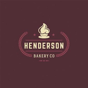 Piekarnia odznaka lub etykieta retro ilustracja cupcake i sylwetki pszenicy do piekarni.