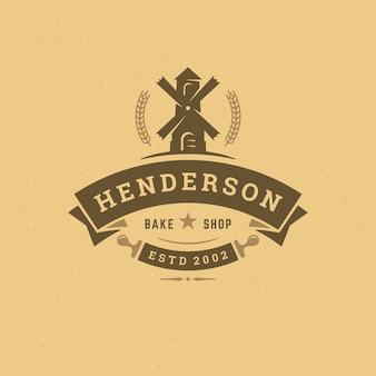 Piekarnia odznaka lub etykieta retro ilustracja młyn sylwetka dla piekarni.