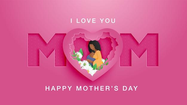 Piękna amerykanin afrykańskiego pochodzenia kobieta z uroczą fryzurą. szczęśliwego dnia matki z matką przytula swoje dziecko oraz styl cięcia kwiatów i papieru