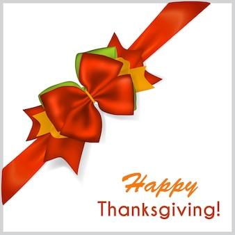 Piękna czerwona kokarda na święto dziękczynienia z ukośną wstążką