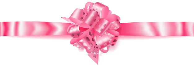 Piękna duża pozioma kokardka wykonana z różowej wstążki z małymi błyszczącymi serduszkami z cieniem na białym tle