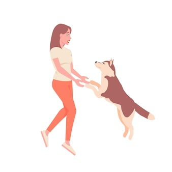 Piękna dziewczyna bawi się z psem