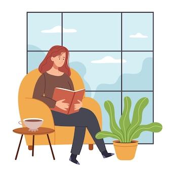 Piękna dziewczyna czyta książkę w pokoju z dużym oknem