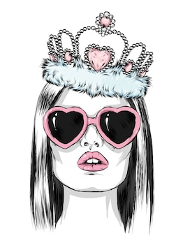 Piękna dziewczyna w okularach w kształcie serca iz koroną