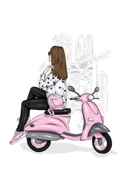 Piękna dziewczyna w stylowe ubrania i rocznika motoroweru
