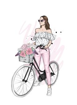 Piękna dziewczyna w stylowe ubrania na rowerze.