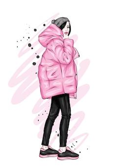 Piękna dziewczyna w stylowe zimowe ubrania