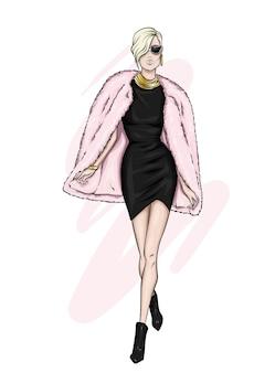 Piękna dziewczyna w stylowej sukience i płaszczu