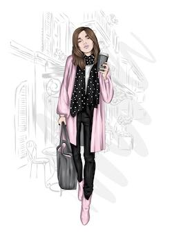 Piękna dziewczyna w stylowy płaszcz i buty