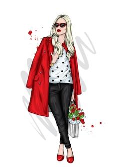 Piękna dziewczyna w stylowy płaszcz i tulipany