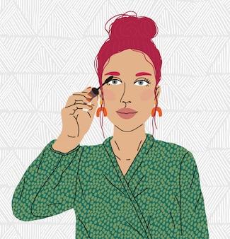 Piękna kobieta malować oko. blogerka makijażu.