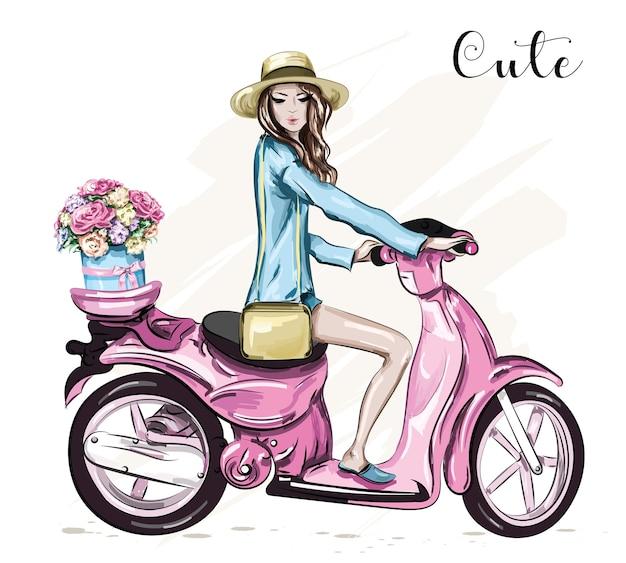 Piękna młoda dziewczyna w kapeluszu z ładny różowy skuter.