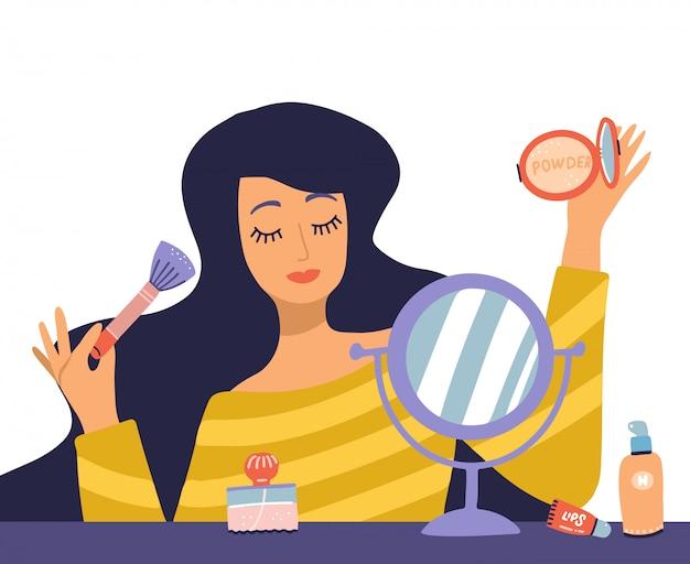 Piękna młoda kobieta postać robi makijaż. stolik z makijażem, kosmetykami i lusterkiem do rany. dziewczyna trzyma pędzel i proszek. ilustracja kreskówka płaska w modnym stylu