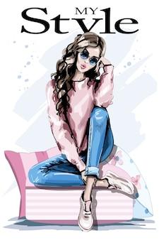 Piękna młoda kobieta siedzi na poduszkach