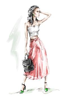 Piękna młoda kobieta w długiej spódnicy.