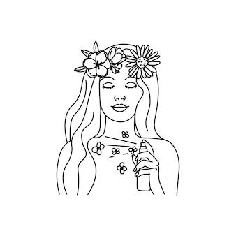 Piękna młoda kobieta w wianku z kwiatów rozpylania w butelce aromatycznych perfum