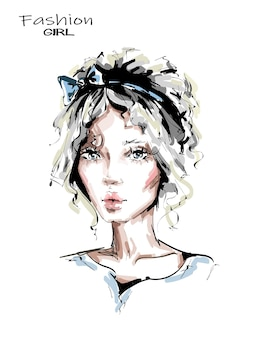 Piękna młoda kobieta z śliczną fryzurą