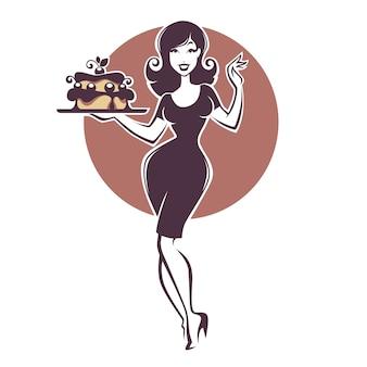 Piękna retro pinup dziewczyna trzyma pyszne pyszne ciasto
