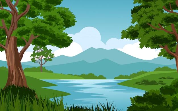 Piękna sceneria przy górą z rzeką i drzewem