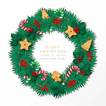 Piękna świąteczna rama z imbirowymi ciastkami i ornamentami