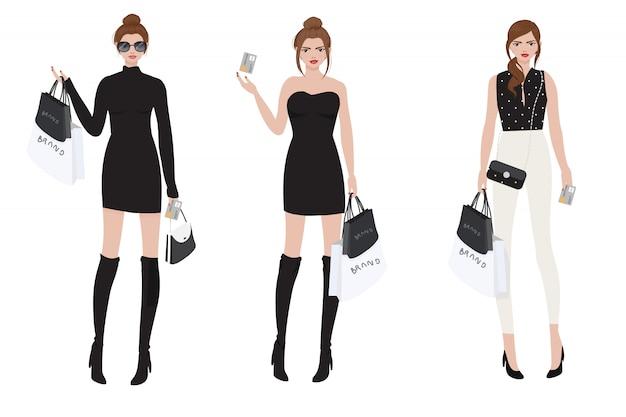 Piękna zamożna dziewczyna robi zakupy marką za pomocą karty kredytowej