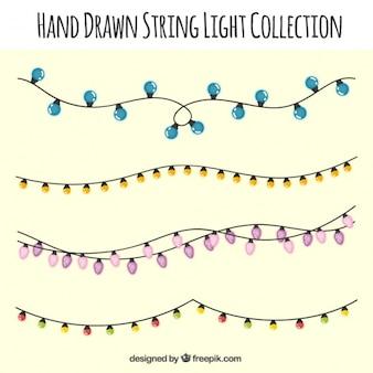 Piękne girlandy rysowane ręcznie różnych świateł