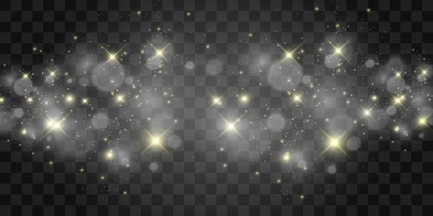 Piękne iskry świecą specjalnym światłem. błyszczy na przezroczystym tle. boże narodzenie abstrakcyjny wzór. piękna ilustracja na pocztówkę. tło obrazu. luminarze.
