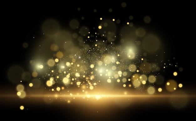 Piękne iskry świecą specjalnym światłem. błyszczy na przezroczystym tle. streszczenie. piękna ilustracja na pocztówkę. tło obrazu.