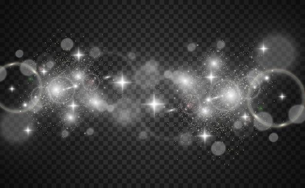 Piękne iskry świecą specjalnymi błyskami światła na przezroczystym tle boże narodzenie abstrakcyjny wzór