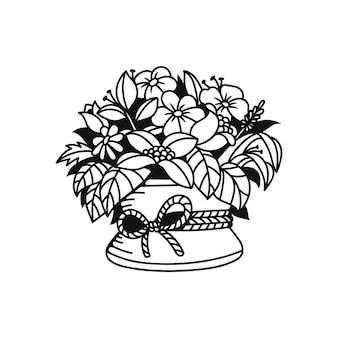 Piękne kwiaty w wiklinowym koszu