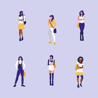 Piękne modelki międzyrasowe dla dziewcząt z torebką